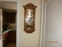Pendulum wall clock chimes half hour and hour