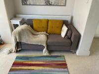 Two seat grey fabric sofa