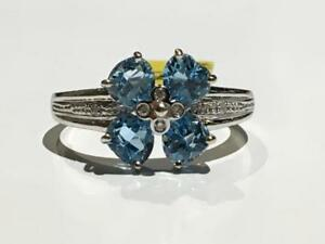 #1562 14K WHITE GOLD LADIES FANCY BLUE TOPAZ FLOWER *SIZE 8 3/4* APPRAISED AT $1450.00 SELLING FOR $495.00!