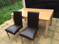 Dinning Table with 4 lathered chairs. Cleaned and Spacious