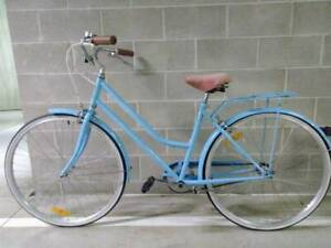 GOOD BLUE BICYCLE WITH 28 INCH WHEELS.