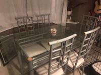6 Seater Glass top modern table with 6 matching chairs
