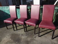 Four burgundy dining chairs.