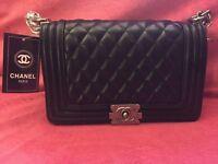 Chanel Classic Le boy handbag in black with metal chain