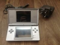 Nintendo DS (includes charger but no games)