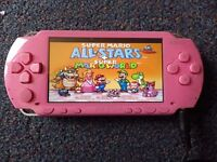 sony psp pink edition with 1000's retro games included