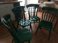 Four pine dining/kitchen chairs painted gloss green. Includes 4 cream seat pads