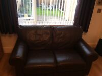 Two seater dark chocolate brown leather sofa in excellent condition