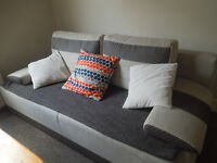 Nice beige/dark grey bed sofa, good condition, big size, furnished with coussins and plaid