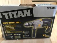 Titan impact drill