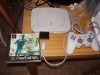 PLAYSTATION SLIMLINE GREAT CONDITION WITH GAME