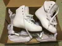 Child's size 12 ice skates. White
