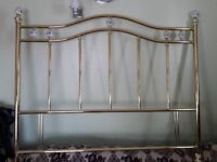 Double bed gold headboard