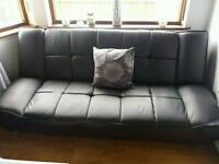 Leather effect sofa bed