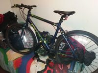 Carrera mountain bike 20 inch frame bike has hardly been used one year old absolutely mint