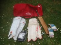 CRICKET EQUIPMENT IN A LARGE HOLDALL