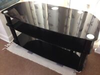 Black Glass TV Table in excellent condition,