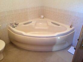 Soft cream corner bath and suite