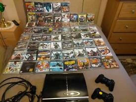 Sony Playstation 3 with 61 games and 2 controllers PS3