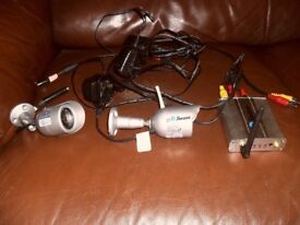 two swann security cameras plus receiver