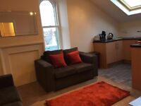 Beautifully Presented One Bedroom Top Floor Fully Furnished Apartment - Central Location