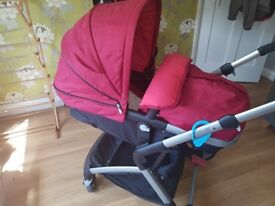 Mothercare roam travel system with car seat. In red