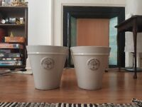 2 medium sized flower pots