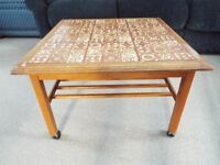 Coffee table solid wood on castor wheels with tile inset and magazine rack