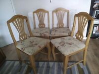 Set of 4 professionally Reupholstered Dining Chairs.