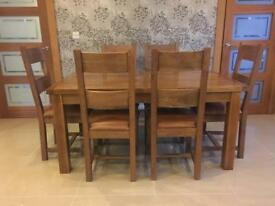 Solid oak extending table & chairs