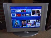 LG Slim panel TV with remote handset.