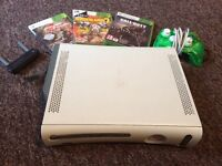 Xbox 360 with games and contoller.