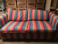 Quality Sofa Bed. Colourful Sofa converts quickly to double bed.