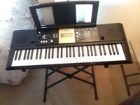 Yamaha YPT-220 keyboard including accessories pictured