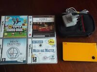 a nice dsi in yellow with games