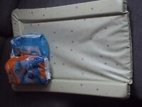 Changing Mat and 12 size 5 swim nappies