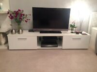 Lovely white TV unit. 160cm wide, with two cupboards. Perfect for any lounge
