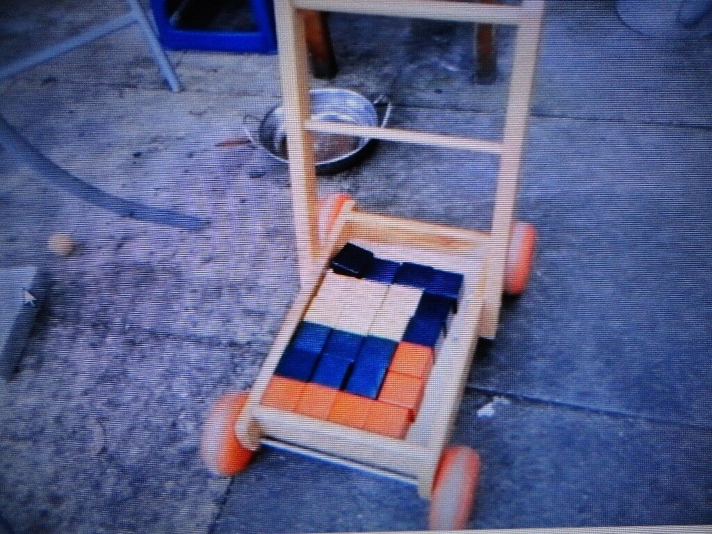 wooden baby walker and wooden blocks