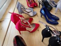 25 pairs of size 8 ladies shoes.