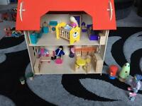 Dolls house, furniture and wooden people.