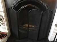 Fire guard. Black metal folding fire guard. Good condition. Decorative and practical.