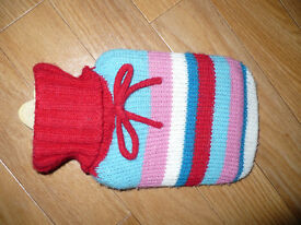 Baby/child size hot water bottle with knitted cover. Good for colics.