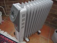Medium free standing electric radiator with a timer