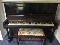 Black 'Brasted (London) piano and stool for sale.