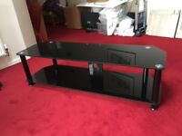 Large black glass TV stand in very good condition suits at least a 55 inch TV