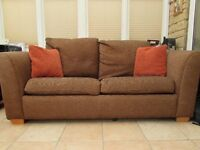 DFS brown sofa bed with matching footstool with hinged lid for storage