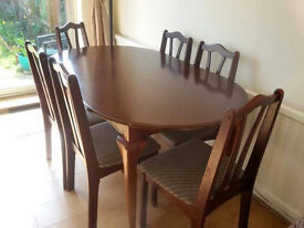 Extendable mahogany dining tables and 6 matching chairs
