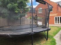 Jump King 14ft x 17ft oval trampoline with net and ladder