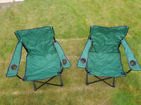 Pair of folding canvas chairs green each with carry bag.
