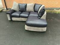 Really nicw BRAND NEW black leather look and grey cord corner sofa .can deliver